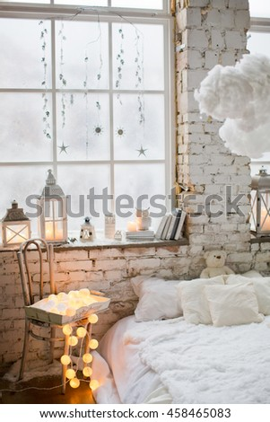 white bedroom with clouds, candles and books