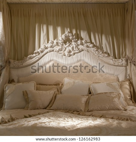 White bedroom with soft light for this romantic picture