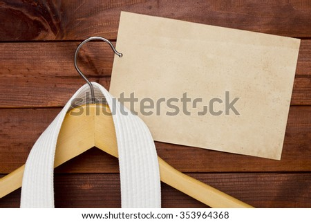 White Belt Karate on a clothes hanger. - stock photo