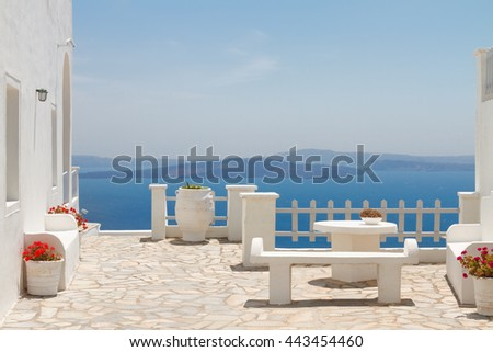 white bench against Aegan sea and volcano caldera, beautiful details of Santorini island, Greece - stock photo