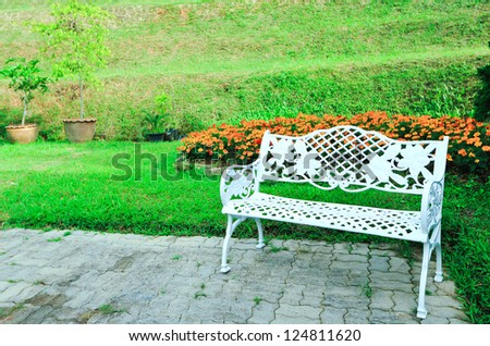 White bench in garden