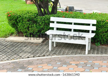 White bench in public garden.