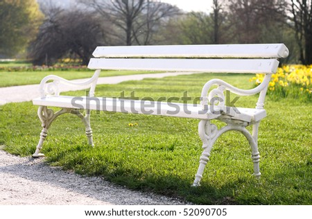 White bench in the park with dew