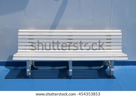 White bench on ferry boat cruise ship deck. Summer travel background.
