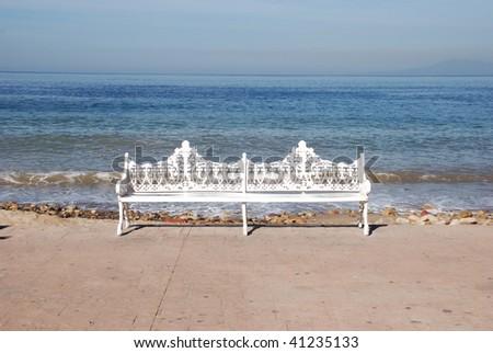 White Bench on the Sea, Downtown Puerto Vallarta, Mexico, - stock photo