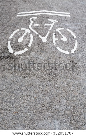 White bicycle sign path with arrow on the road
