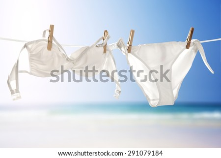 white bikini rope and swim suit with summer time