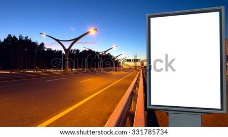 White billboard on lighting highway at night - stock photo