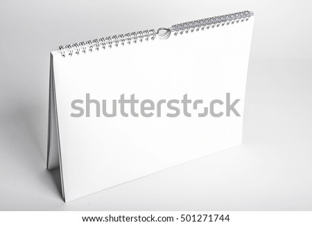 white blank calendar mockup with spiral binding seen from above