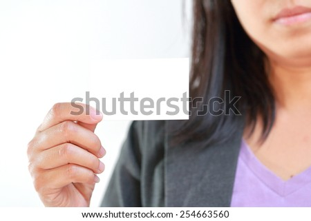 White blank card, Business woman holding card that can be replace with namecard,sign etc. - stock photo