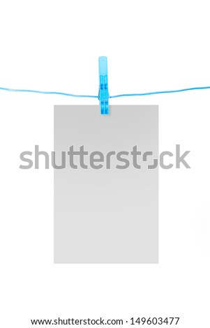 White, blank card on rope with blue, plastic clothespin, isolated on white background.