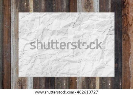 White blank crumpled paper on grunge wooden table, creased paper texture for background