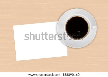 White blank empty card with cup of black coffee drink on wooden table. - stock photo
