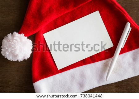 White blank greeting card pen red stock photo royalty free white blank greeting card pen and red hat letters to santa claus from children spiritdancerdesigns Gallery