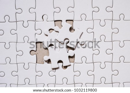 White Blank Jigsaw Puzzle Piece Business Concept For Complete And Teamwork