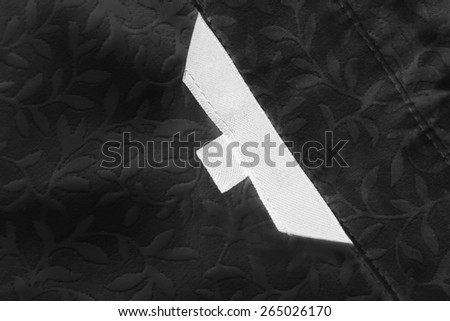 White blank label on black lacy cloth as a background - stock photo