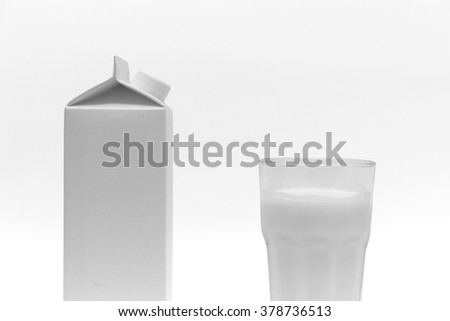 White blank milk box and a glass of milk, on white background