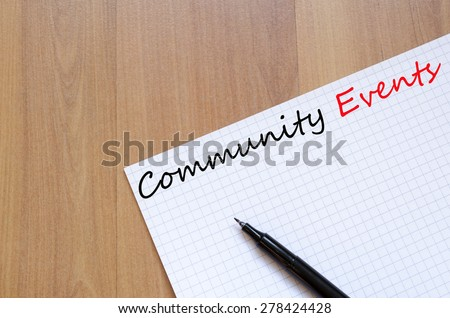 White blank notepad on office wooden table Community Events concept