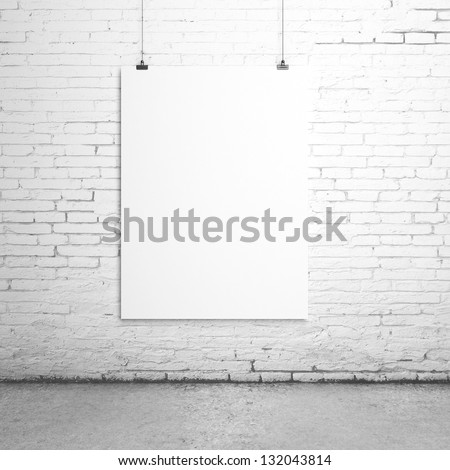 white blank paper clips on brick room - stock photo