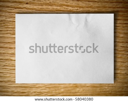 white blank paper on red oak wood background - stock photo