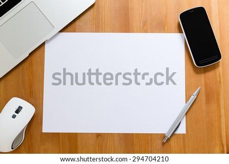 White blank paper on working desk for user to insert something  - stock photo
