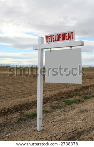White blank real estate sign in the country - stock photo