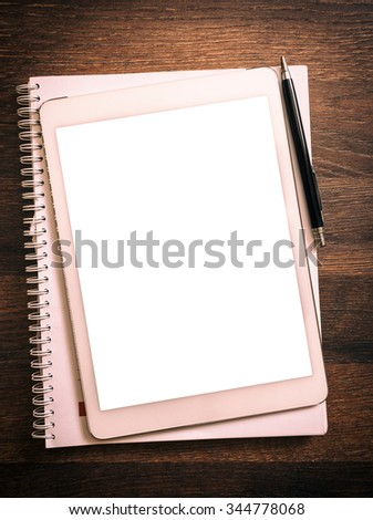 White blank screen on the tablet pc on wooden background for your ads  - stock photo