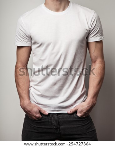 White blank t-shirt on young athletic man, front - stock photo
