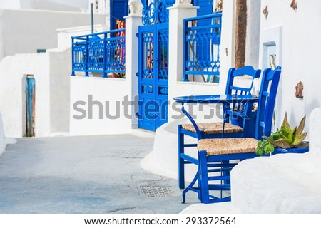 White-blue architecture on Santorini island, Greece. Old street in Pyrgos town - stock photo
