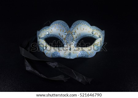 white blue masquerade party mask on isolated black