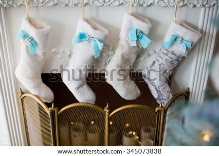 White-blue stockings over the fireplace