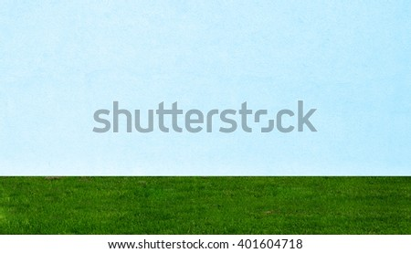 white blue wall and green grass texture background  - stock photo