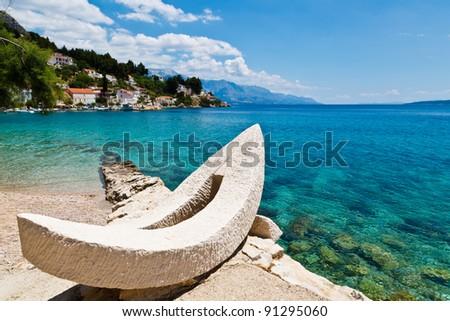 White Boat on the Beach and Azure Mediterranean Sea near Split, Croatia - stock photo