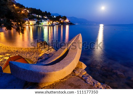White Boat on the Beach and Transparent Mediterranean Sea in the Night, Croatia - stock photo