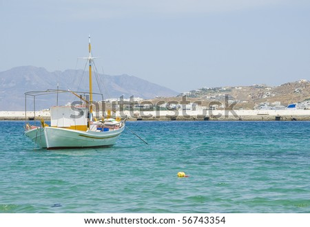 White boat, waiting to go to sea, at anchor in the bay on the island...