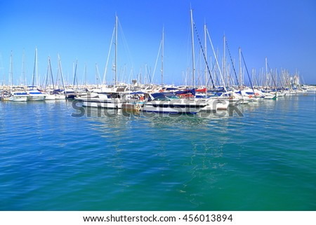 white boats near the pier inside the marina of Alicante, Spain