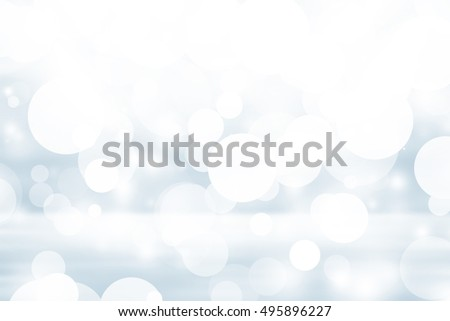 white bokeh blur background / Circle light on blue background