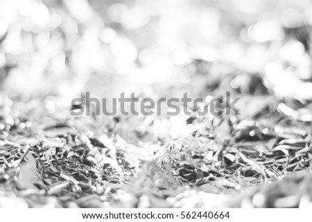 white bokeh from foil paper background texture, gray abstract