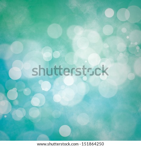 White bokeh on blue and green grunge background - stock photo