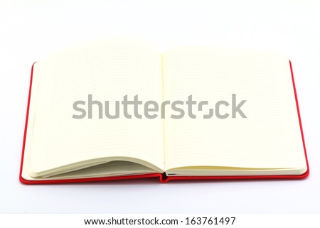 White book open on white background.