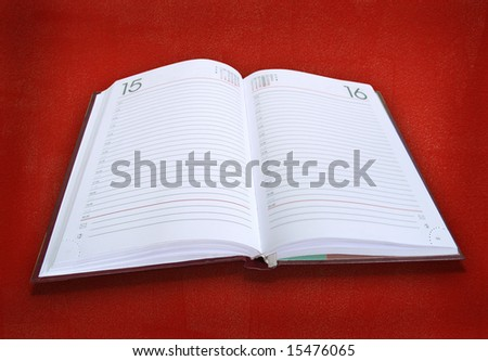 white book. personal diary  on  red background