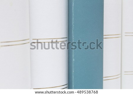 white book shelf whit blue close-up