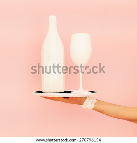 White bottle and glass on a tray. fashion design - stock photo