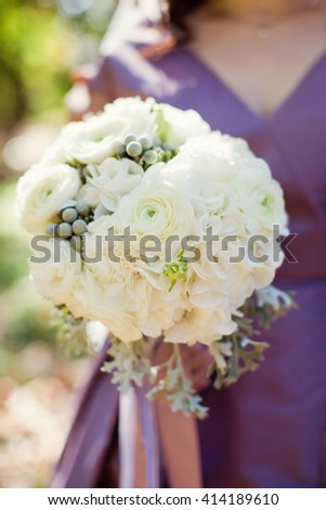 white bouquet of ranunculus, eustoma and brunia