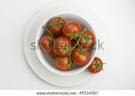 White bowl full of vine tomatoes - stock photo