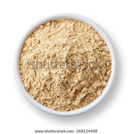 White bowl of maca powder isolated on white background - stock photo
