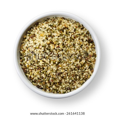 White bowl of shelled hemp seeds isolated on white background - stock photo