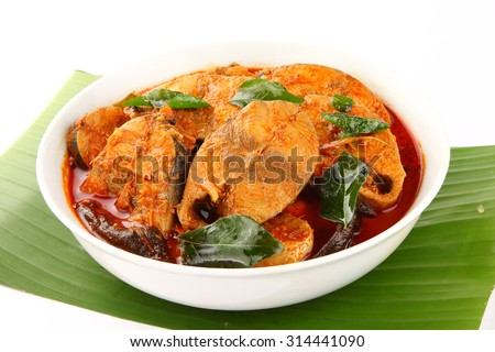 White bowl of spicy Asian style tuna fish curry. - stock photo