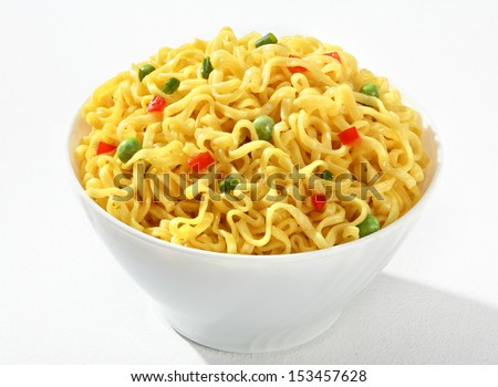 White bowl with cooked noodles / vermicelli with green peas and chopped bell pepper in a white bowl - on white background  - stock photo