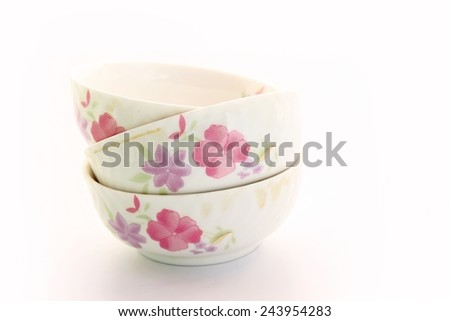 White bowls with prints on white background.